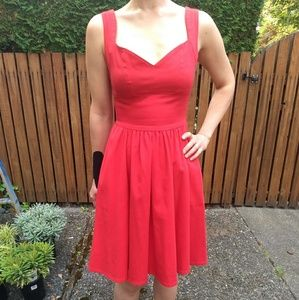 Red dress with vintage flair and sweetheart style